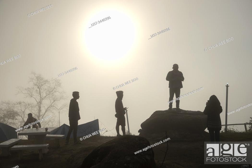 Stock Photo: Rear view of people looking at sunrise in Phu Thab Buek, Phetchabun, Thailand.