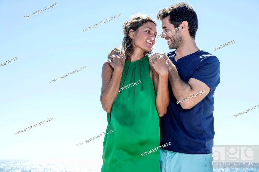 Stock Photo: Spain, Mid adult couple looking at each other, smiling.