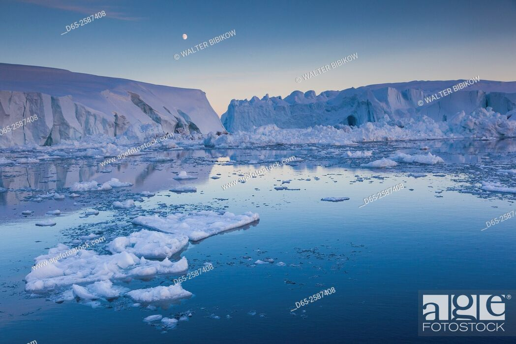 Stock Photo: Greenland, Disko Bay, Ilulissat, floating ice at sunset with moonrise.