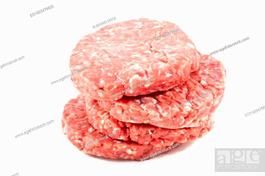 Stock Photo: raw hamburgers with transparent protective film.