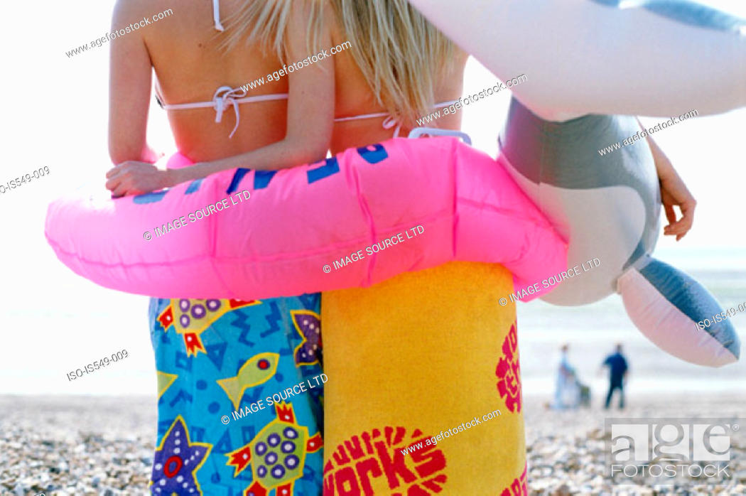 Stock Photo: Girls on the beach with inflatable lifebelt.