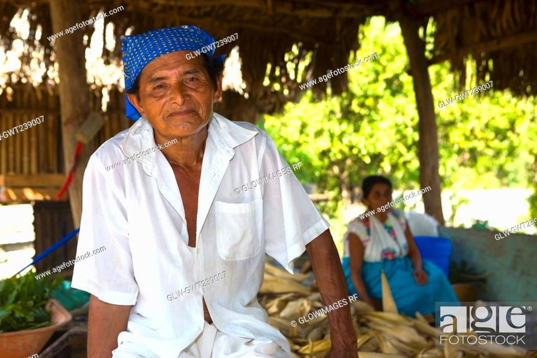 Stock Photo: Portrait of a mature man with his wife in the background, Papantla, Veracruz, Mexico.