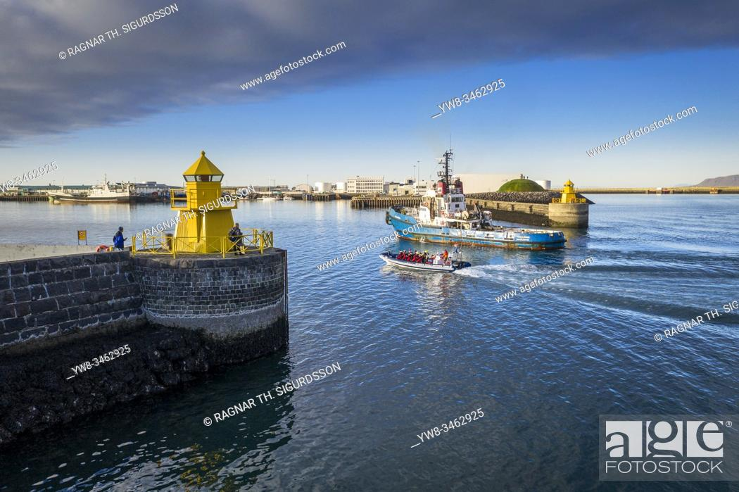 Stock Photo: Lighthouse, whale watching and fishing boat, Reykjavik, Iceland.