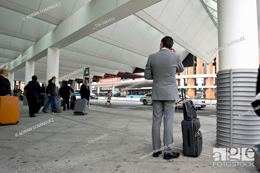 Stock Photo: Executive waiting in Atocha train station in Madrid, Spain.