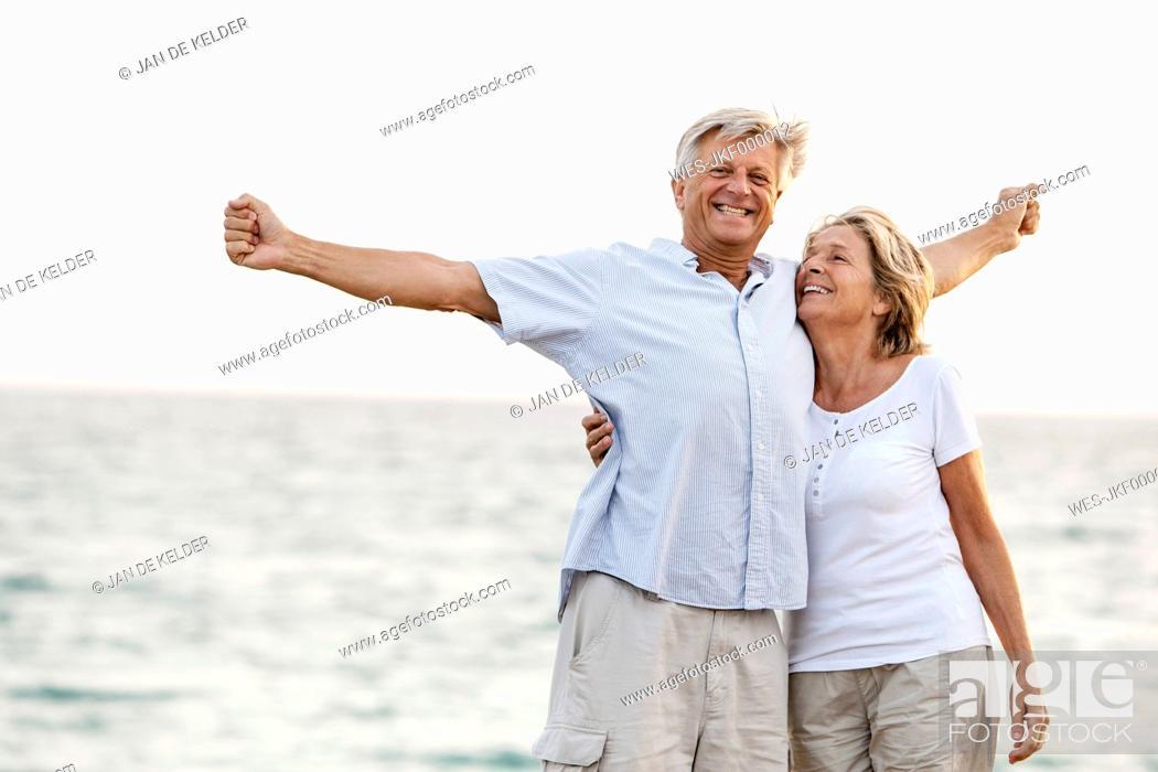 Stock Photo: Spain, Senior couple having fun at the sea.