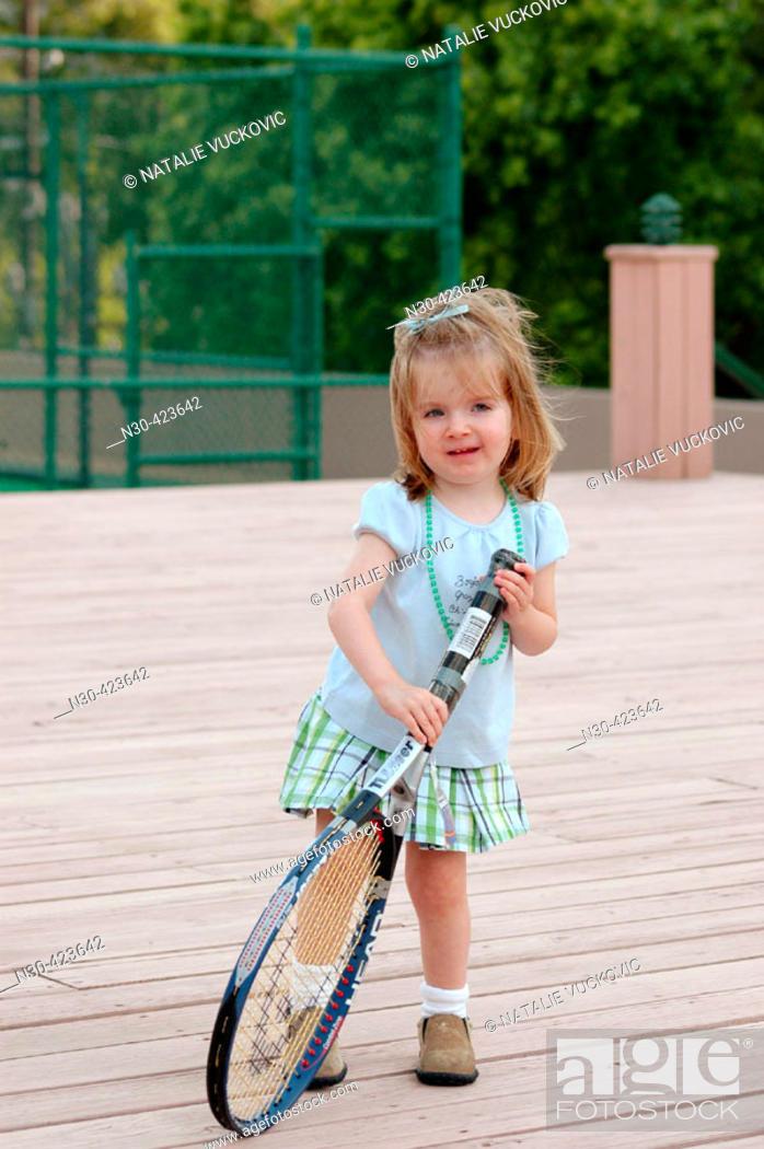 Stock Photo: Toddler girl holding tennis racquet.