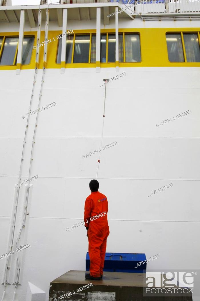 Stock Photo: Painting a Comarit ferry boat in the port of Tangier, Morocco.