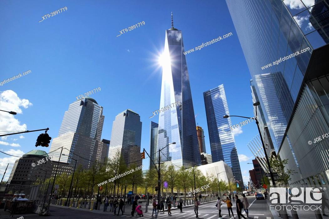 Stock Photo: looking up at sun reflecting off one world trade center from national september 11th memorial site New York City USA.