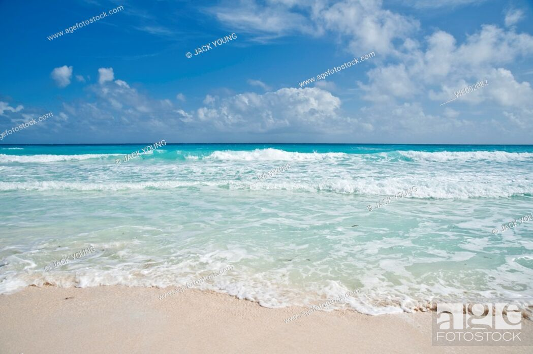 Stock Photo: Gentle waves on a white tropical beach.