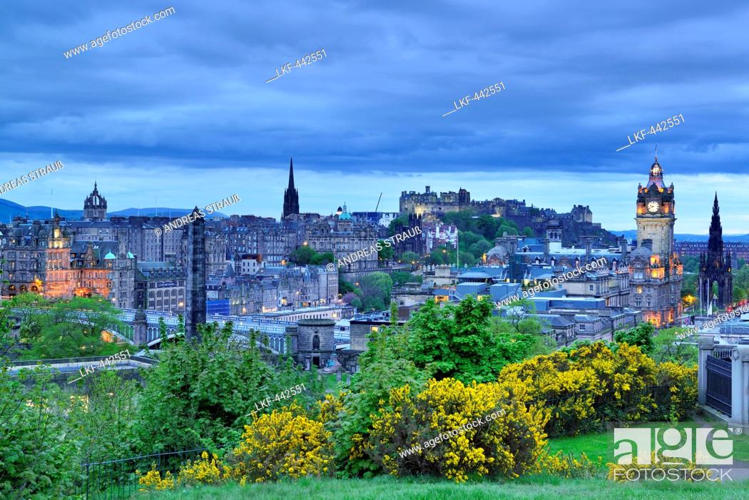 Stock Photo: View to city of Edinburgh, illuminated at night, with St. Giles' Cathedral, Edinburgh castle and Balmoral Hotel, Calton Hill.
