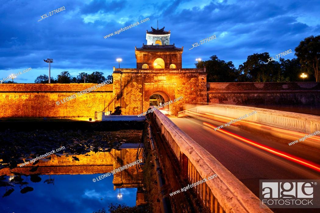 Stock Photo: Moat and wall of The Citadel (Imperial City) illuminated at dusk. Hue, Vietnam.