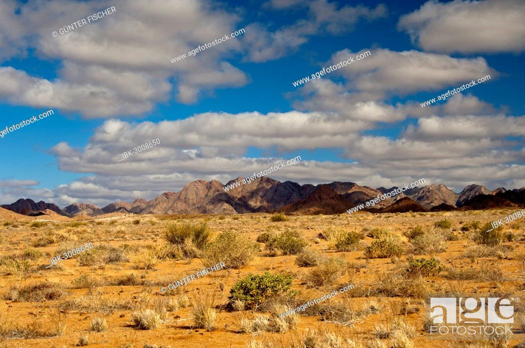 Stock Photo: A blue sky with white clouds over the mountainous desert landscape, Richtersveld Transfrontier National Park, Northern Cape, South Africa.