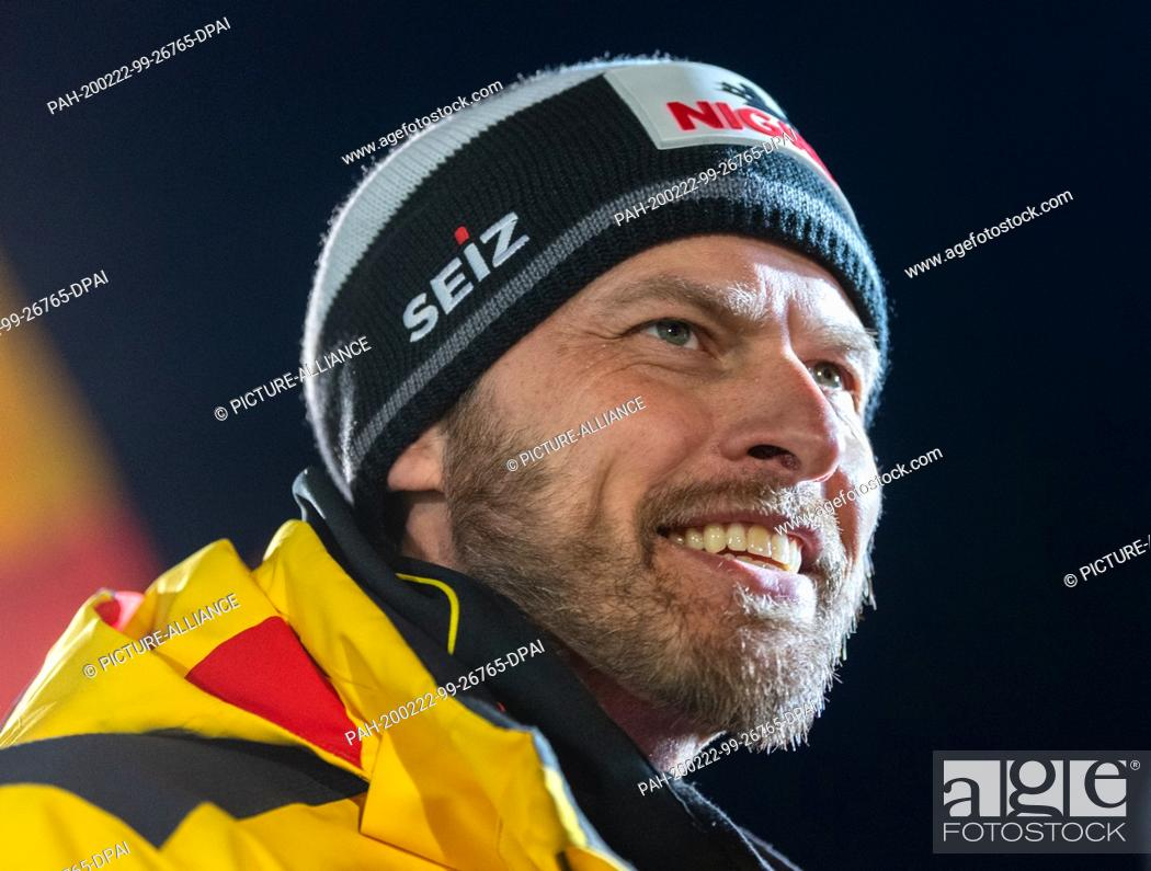 Stock Photo: 22 February 2020, Saxony, Altenberg: Bob: World Championship, two-man bobsleigh, women, fourth heat. National coach Rene Spies laughs after the race.