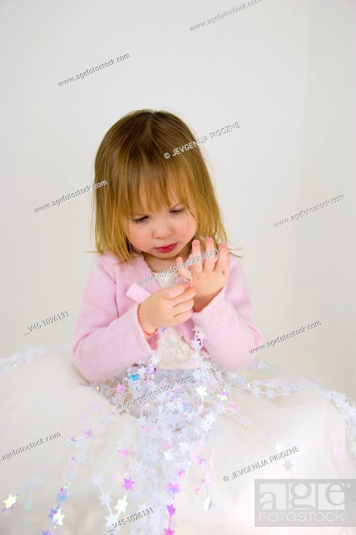 Stock Photo: 2 years old girl dressed as a star princess.