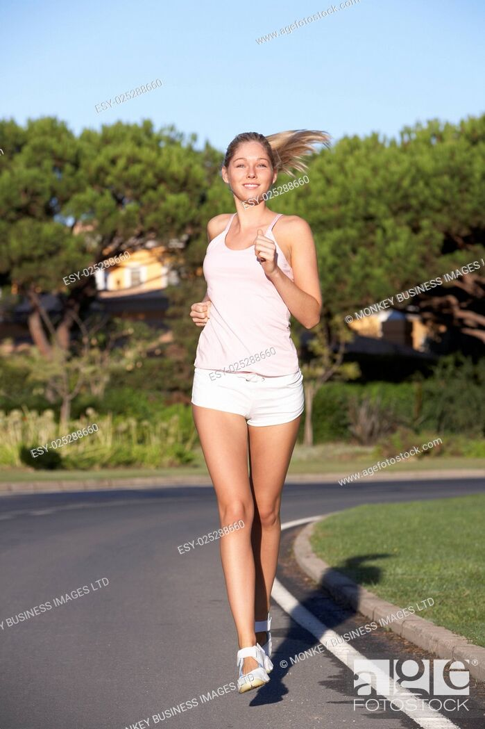 Stock Photo: Woman Running On Road.
