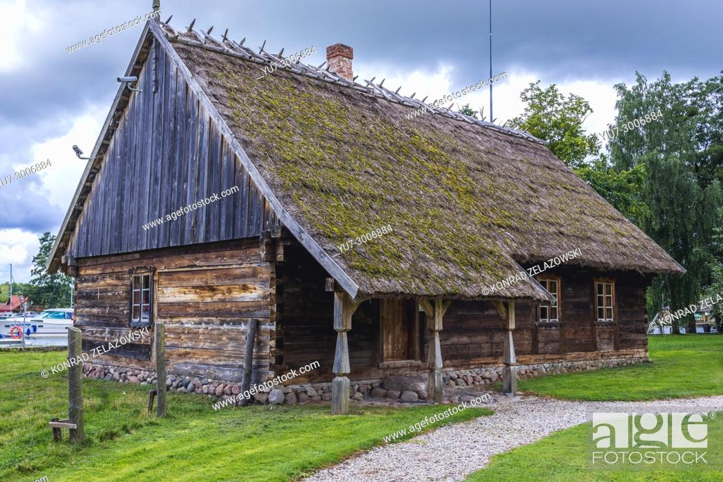 Stock Photo: 19th century wooden cottage in Museum of Folk Culture in Wegorzewo town, Warmian-Masurian Voivodeship of Poland.