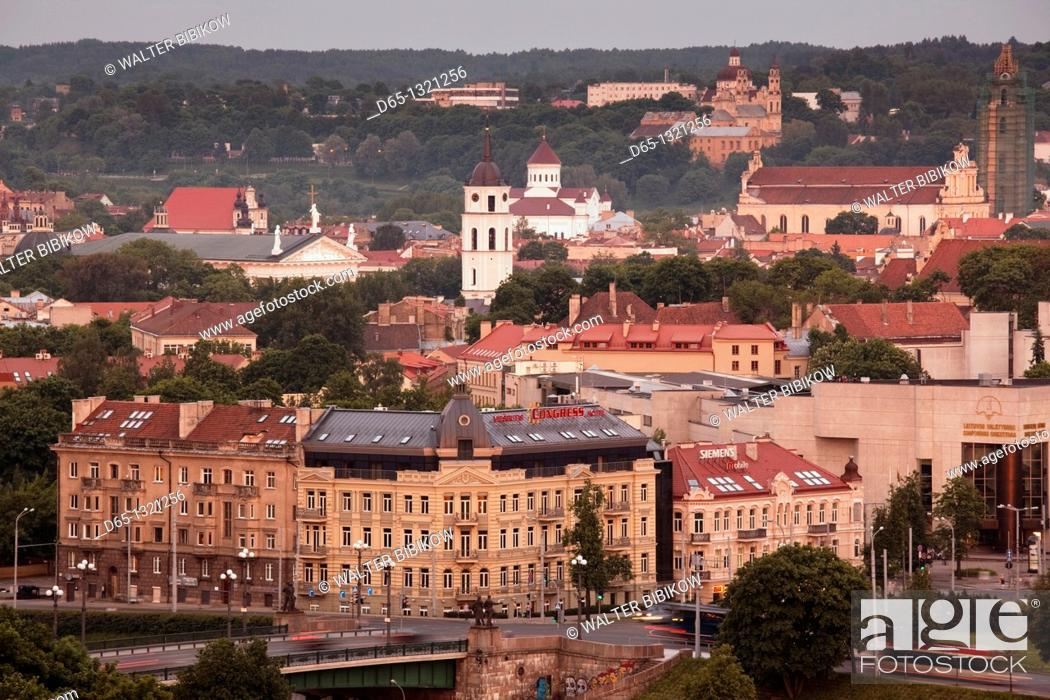Stock Photo: Lithuania, Vilnius, elevated view of Old Town and Green Bridge, dusk.