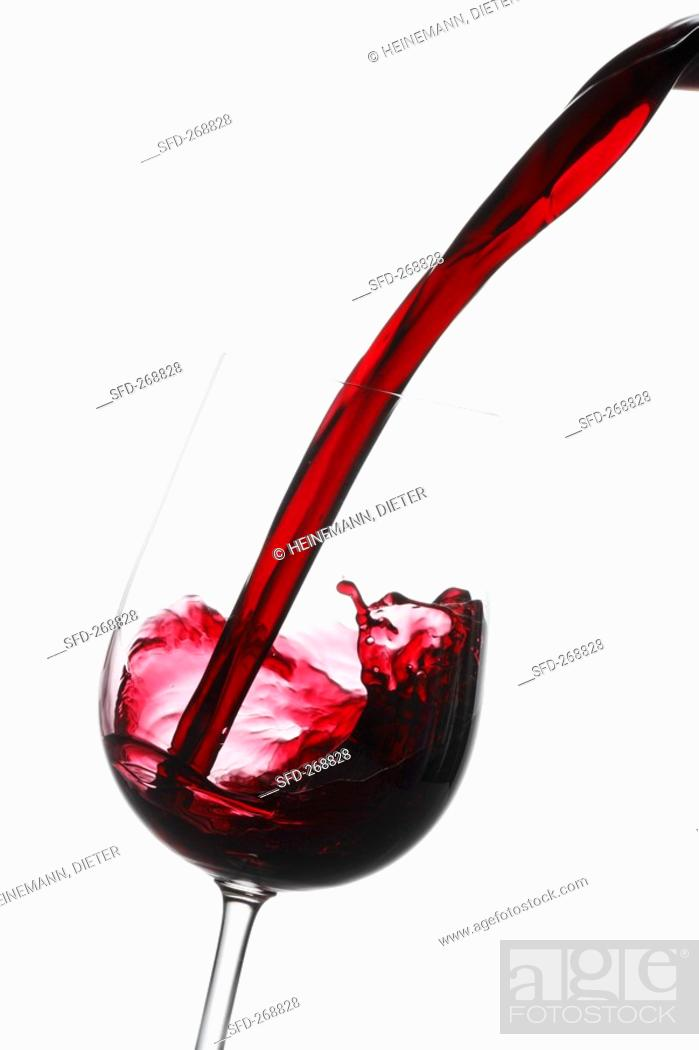 Photo de stock: Pouring red wine into a glass.