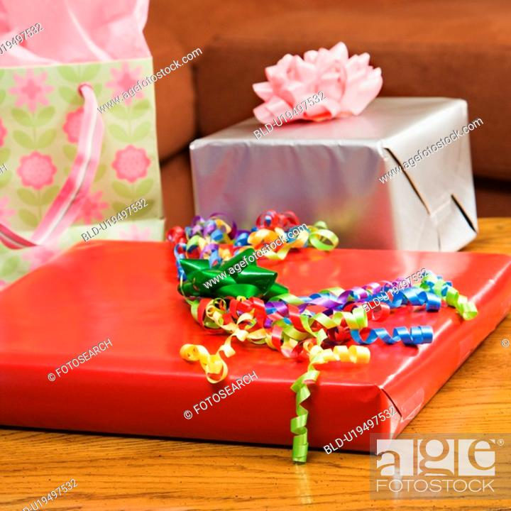 Stock Photo: Presents wrapped and decorated with bows on a table.