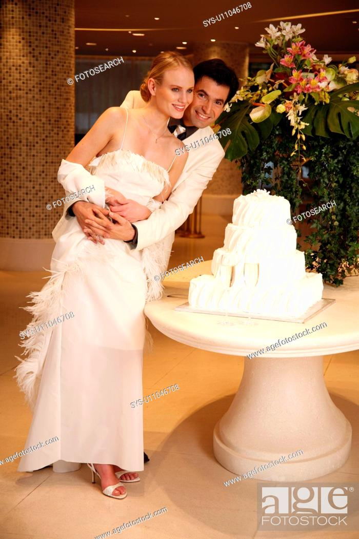 Stock Photo: Bride and groom with cake.
