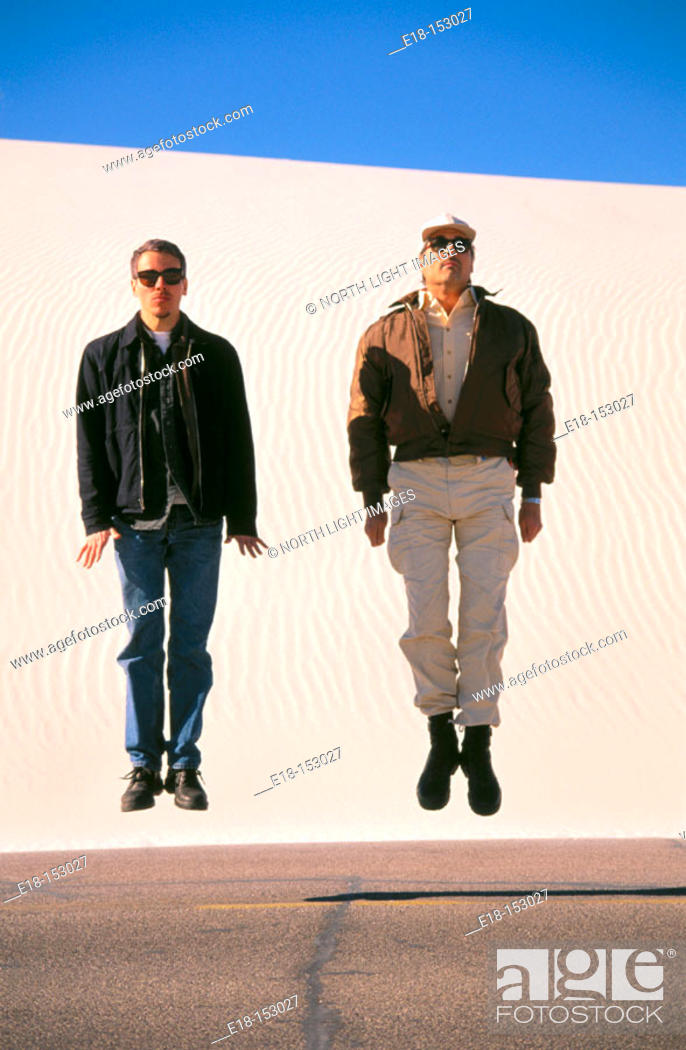 Stock Photo: Two men jumping. White Sands National Monument. Alamogordo. New Mexico. USA.