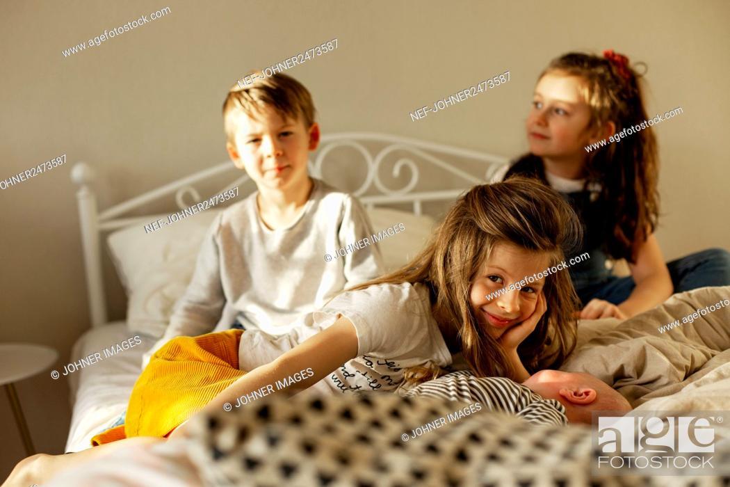Stock Photo: Children on bed.