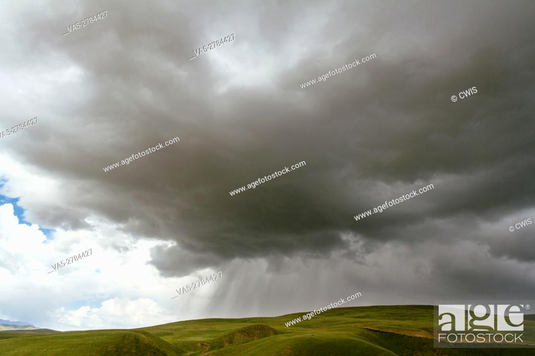 Stock Photo: The view of the storm on the grassland in the daytime.