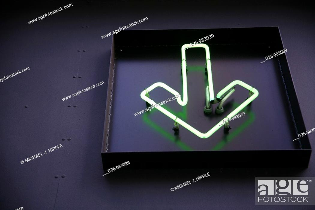 Stock Photo: Green arrow neon sign.