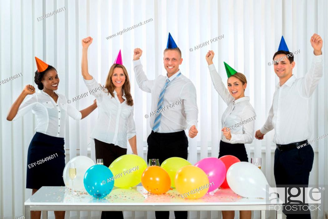Stock Photo: Group Of Happy Businesspeople Celebrating Success During Party In Office.