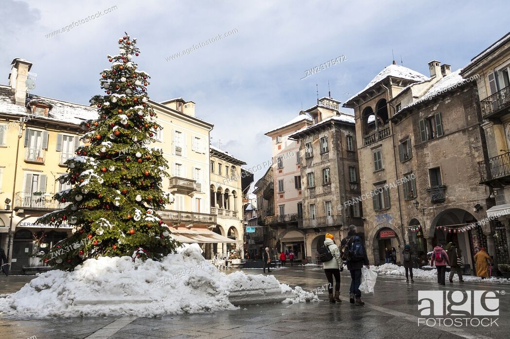 Stock Photo: Christmas decorations at the Market Square after the snowstorm. Domodossola, Piedmont. Italy.