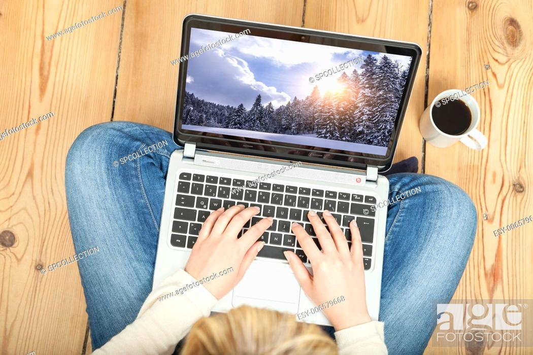 Stock Photo: booking christmas vacation on laptop.