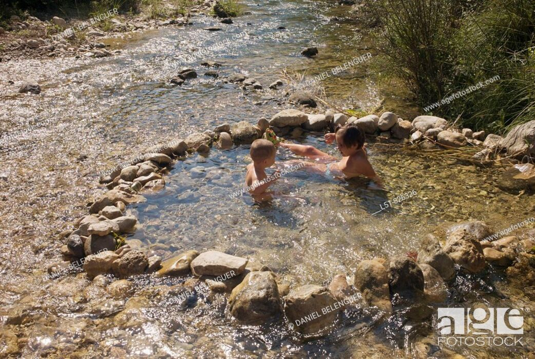 Stock Photo: Brothers playing on a handmade pool on Villahermosa river, Ludiente, Castellón, Comunidad Valenciana, Spain, Europe.