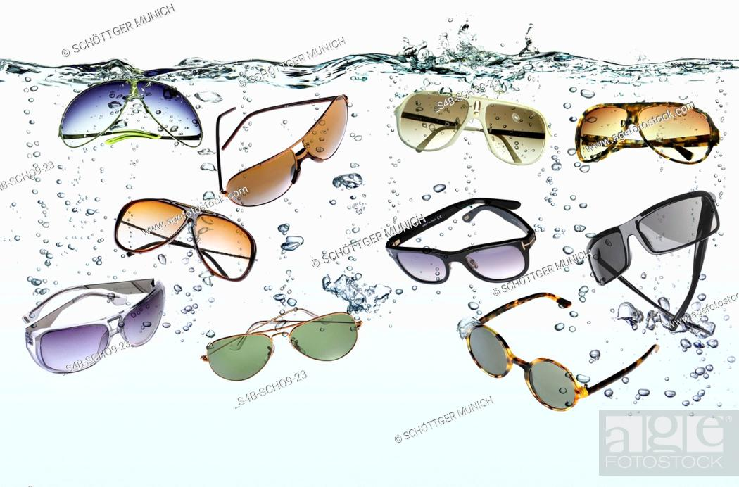 Stock Photo: Sunglasses sinking in water.