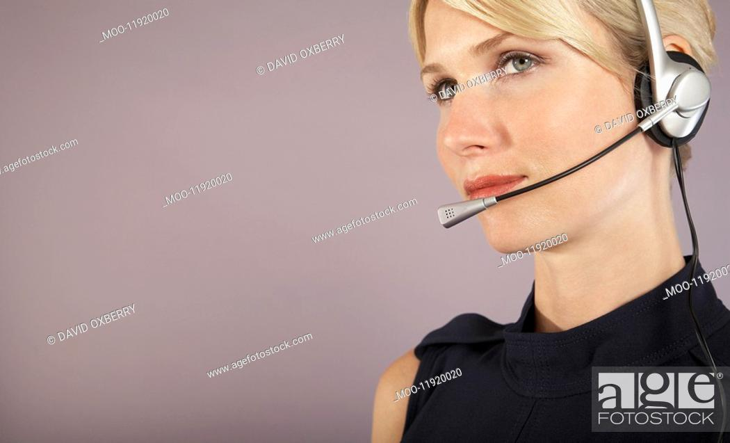 Stock Photo: Businesswoman wearing headset close-up portrait.
