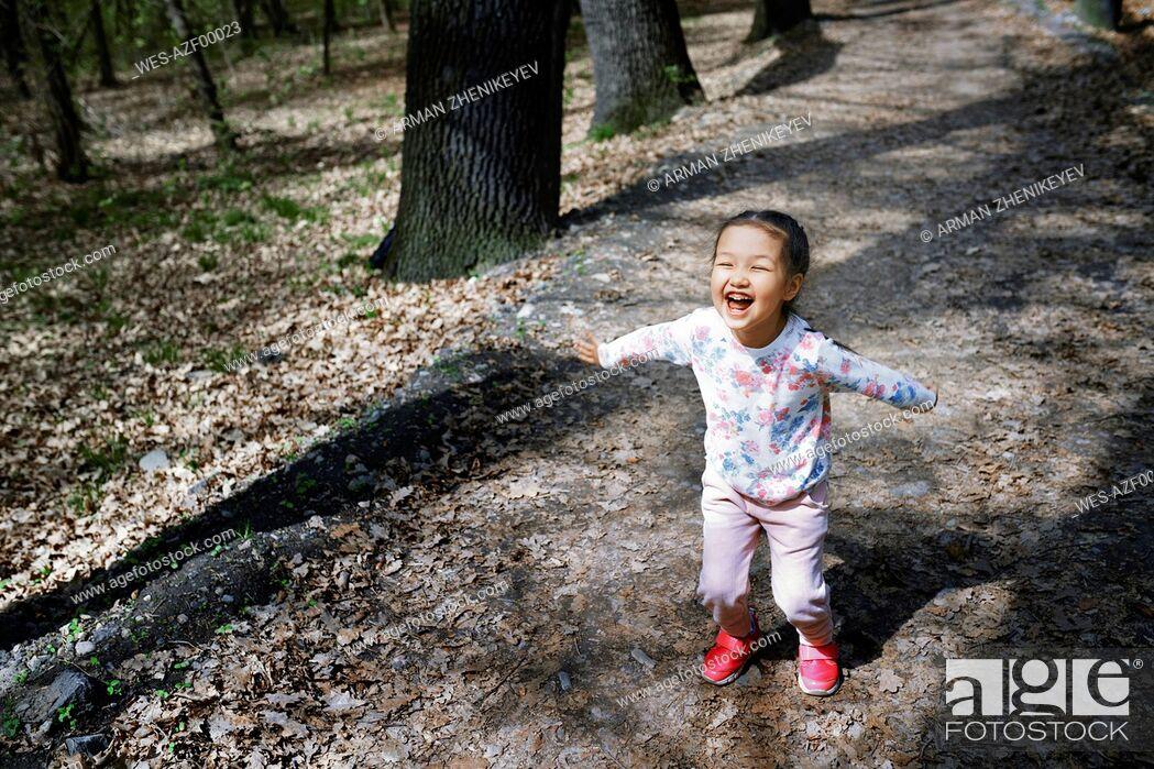 Stock Photo: Little girl having fun in a park.