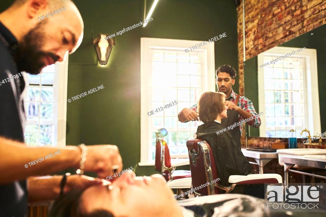 Stock Photo: Male barbers working in barbershop.
