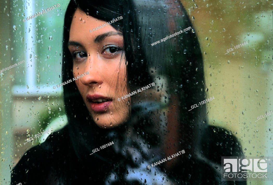 Stock Photo: Arab woman behind a window.
