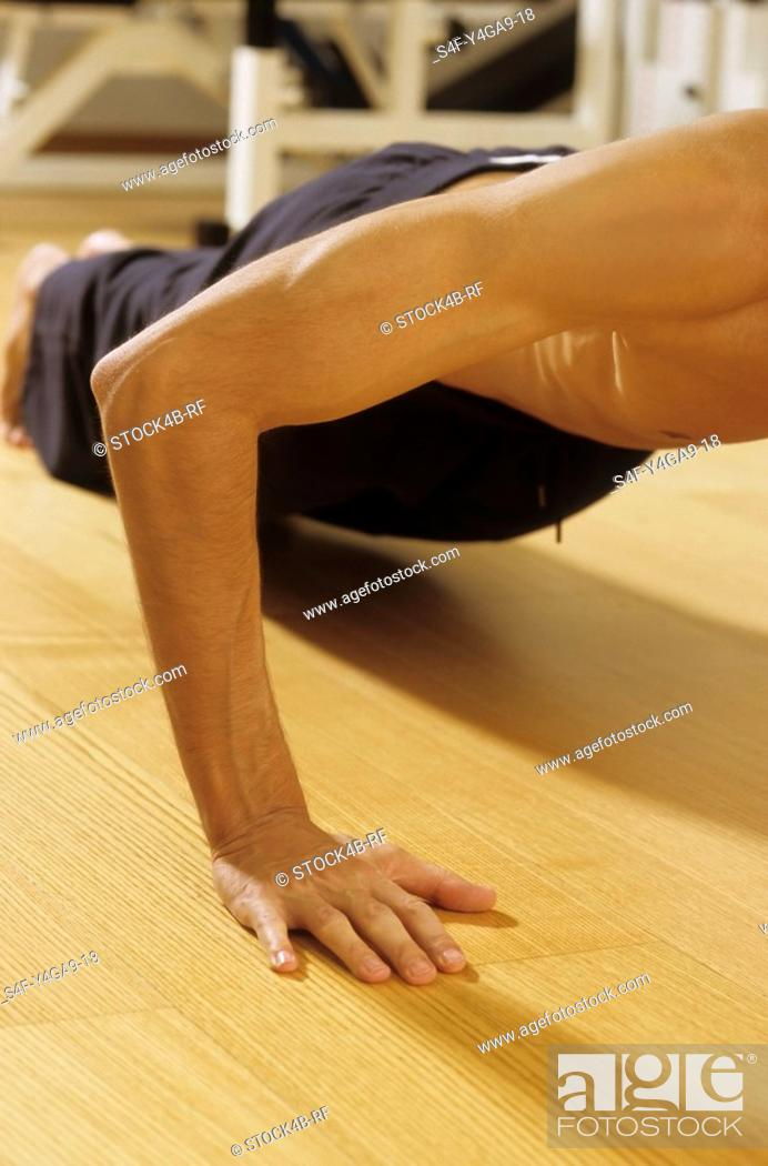 Stock Photo: Man doing Press-Ups - Sportiness - Gymnastics.