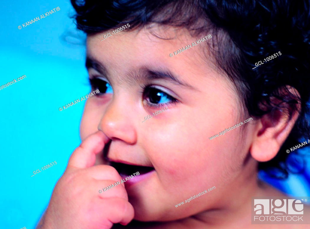 Stock Photo: Toddler with finger in her nose.