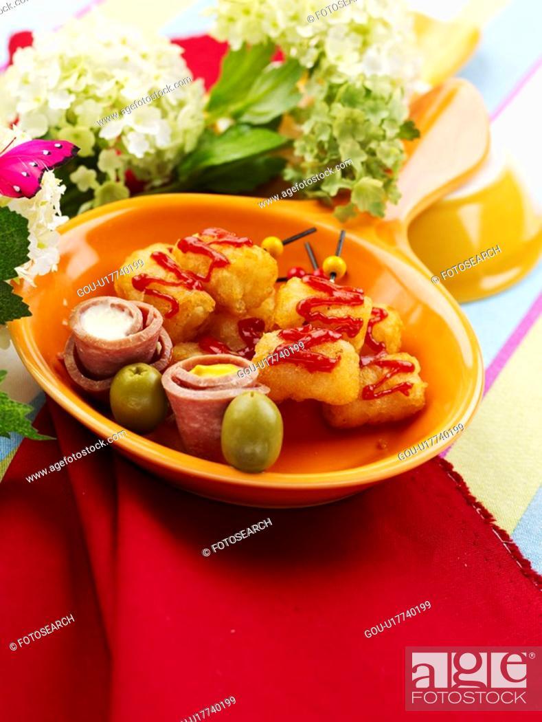 Stock Photo: flower, stuffed olive, napkin, tablecloth, pan, food styling, ham roll-ups.
