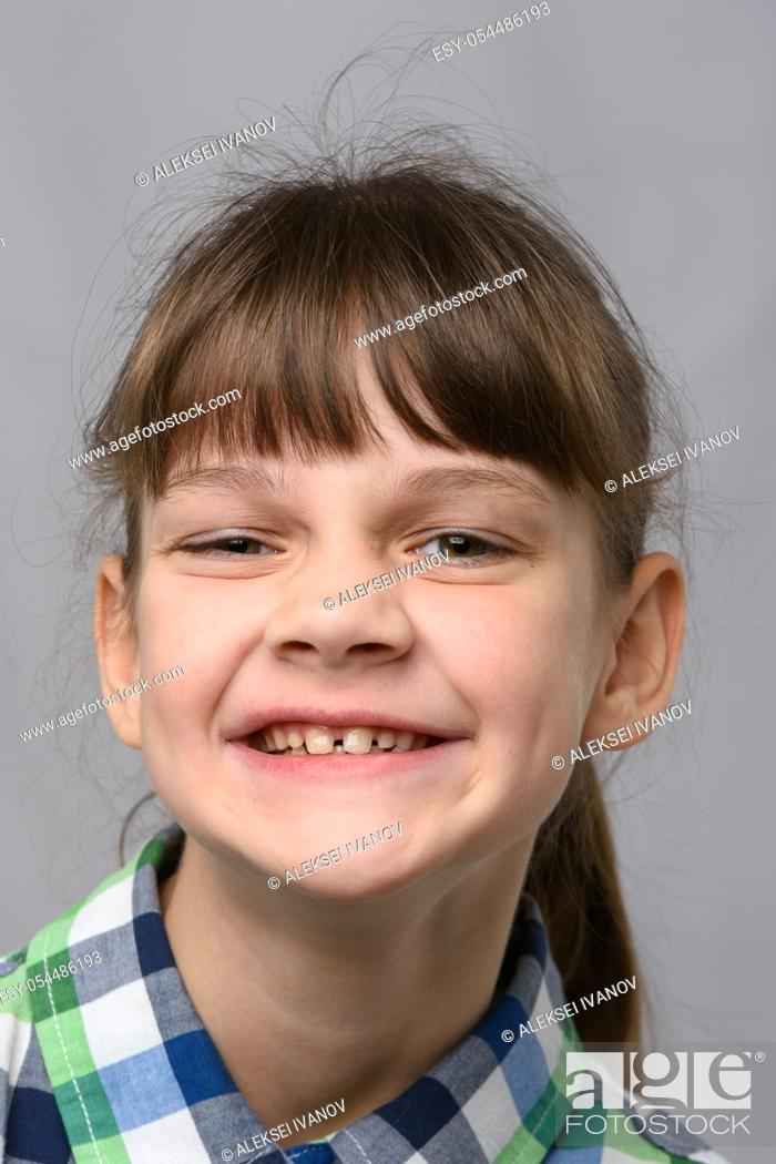 Stock Photo: Portrait of a funny smiling ten-year-old girl of European appearance, close-up.