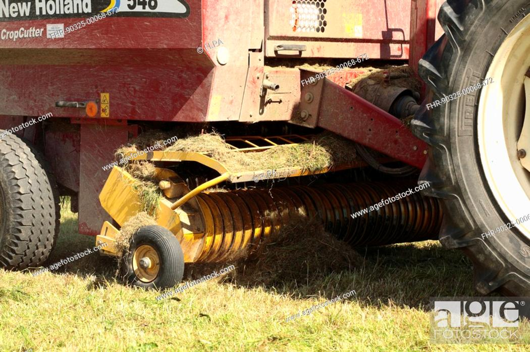 Silage crop, close-up of New Holland round-baler front and