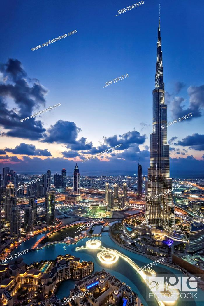 Stock Photo: View from above of the Burj Khalifa (Armani Hotel) designed by Skidmore Owings and Merrill , the Souk Al Bahar and the Dubai Fountains at twilight, Business Bay.