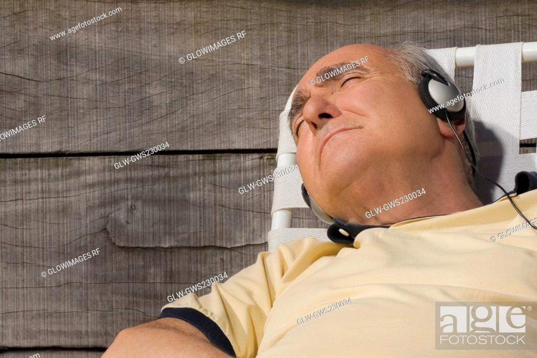 Stock Photo: Close-up of a senior man listening to music.
