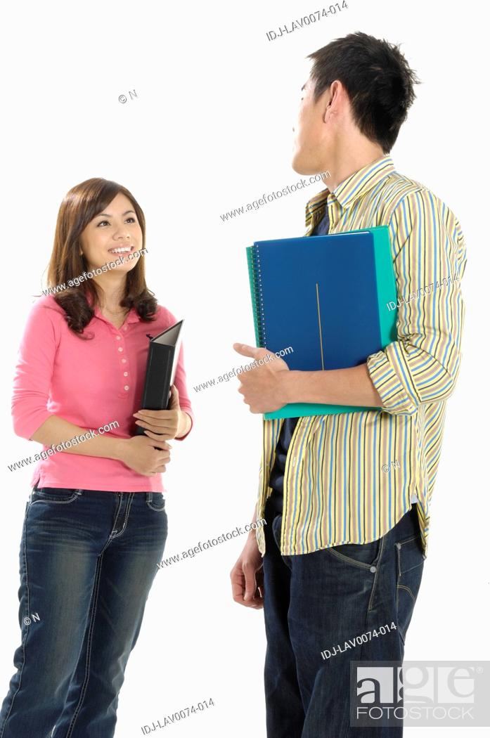Stock Photo: University students smiling at each other.