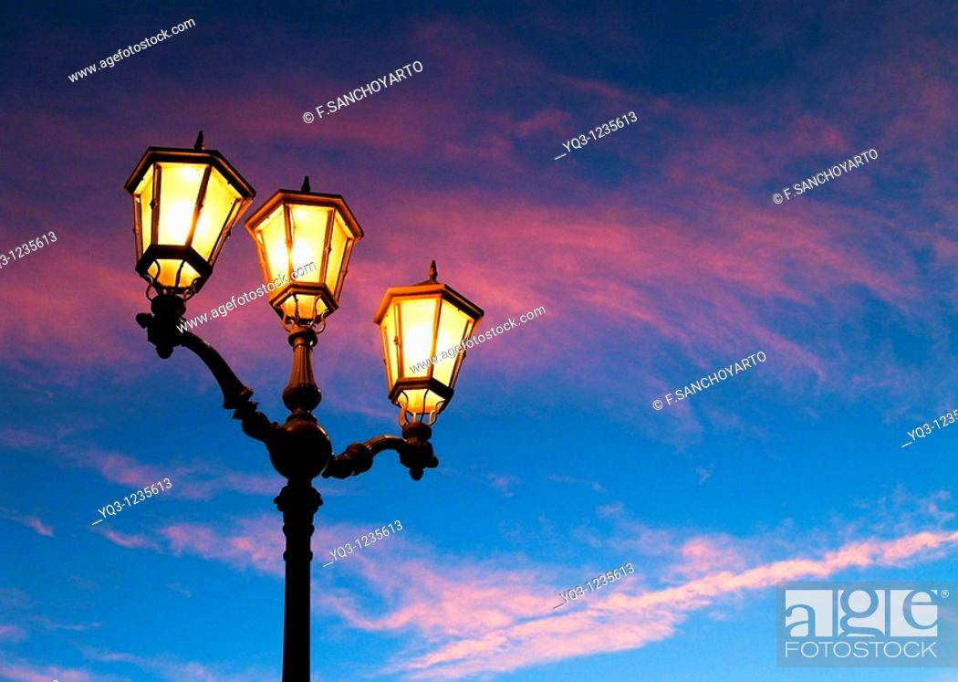 Stock Photo: Street lamps in the early morning. Port of Castro Urdiales , Cantabria, Spain.