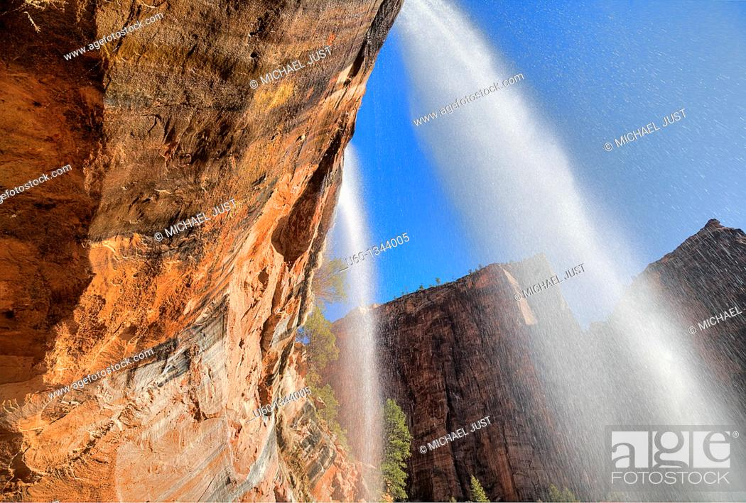 Stock Photo: Twin falls are produced from the Emerald pools at Zion National Park,Utah.