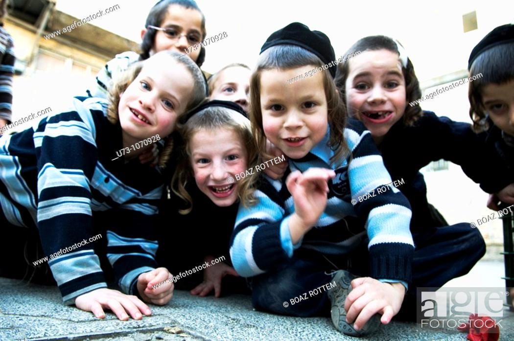 Stock Photo: cute Jewish orthodox boys having fun with the camera in their Yeshiva / school in the religious neighborhood of Mea Shearim in Jerusalem.