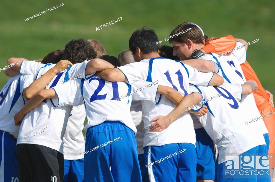 Stock Photo: Soccer Team Huddling.