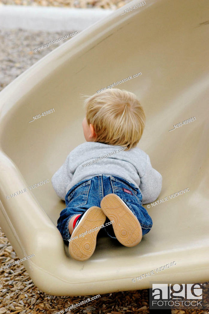 Stock Photo: Rear view of toddler on slide.